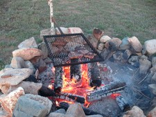 We cook great steaks over the campfire at hunting camp..