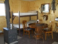 The wood stove keeps this cabin warm and comfortable for our hunters.